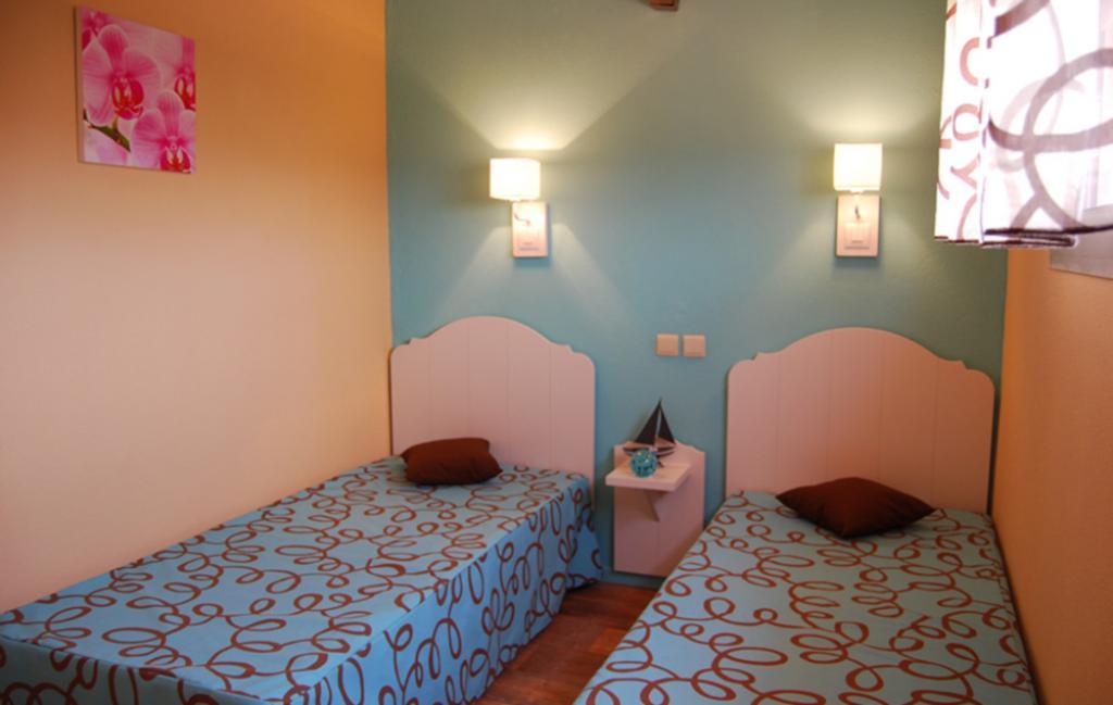 Slide une chambre avec 2 lits simples
