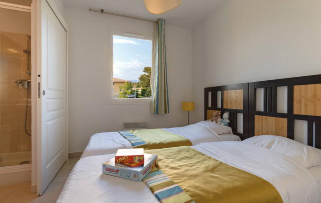 Slide un exemple de chambre avec 2 lits simples