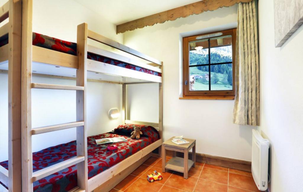 Slide un exemple de chambre avec 2 lits superposés
