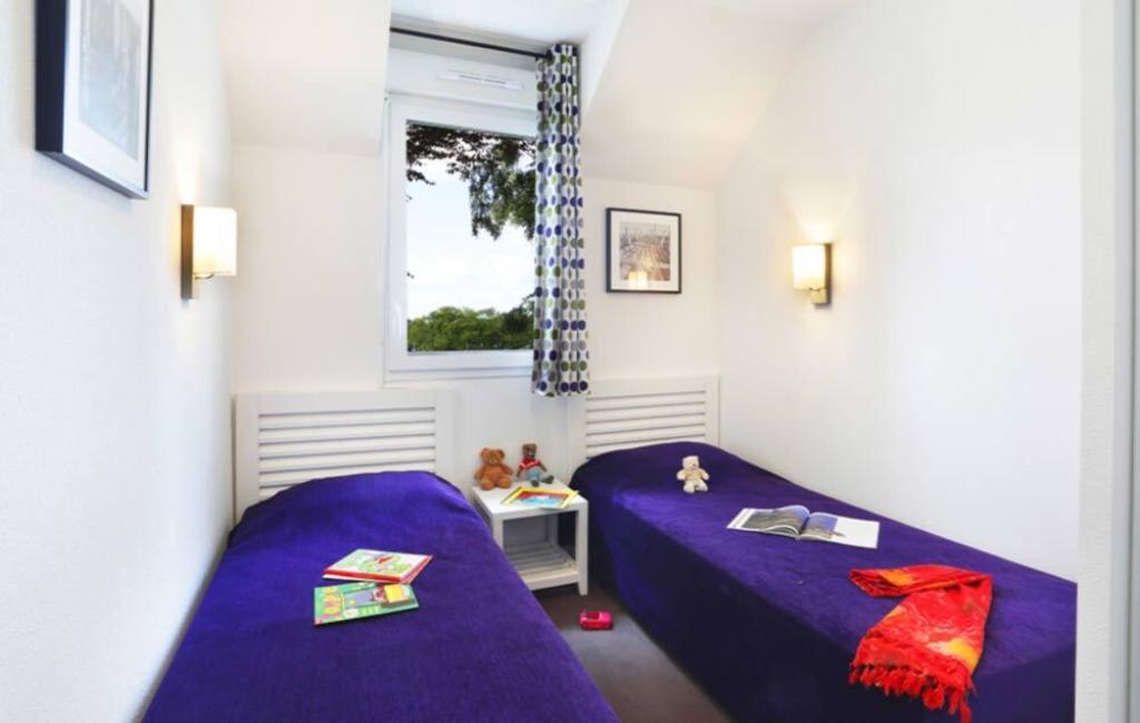 Slide Chambre lits jumeaux - Le Domaine de la Baie ***