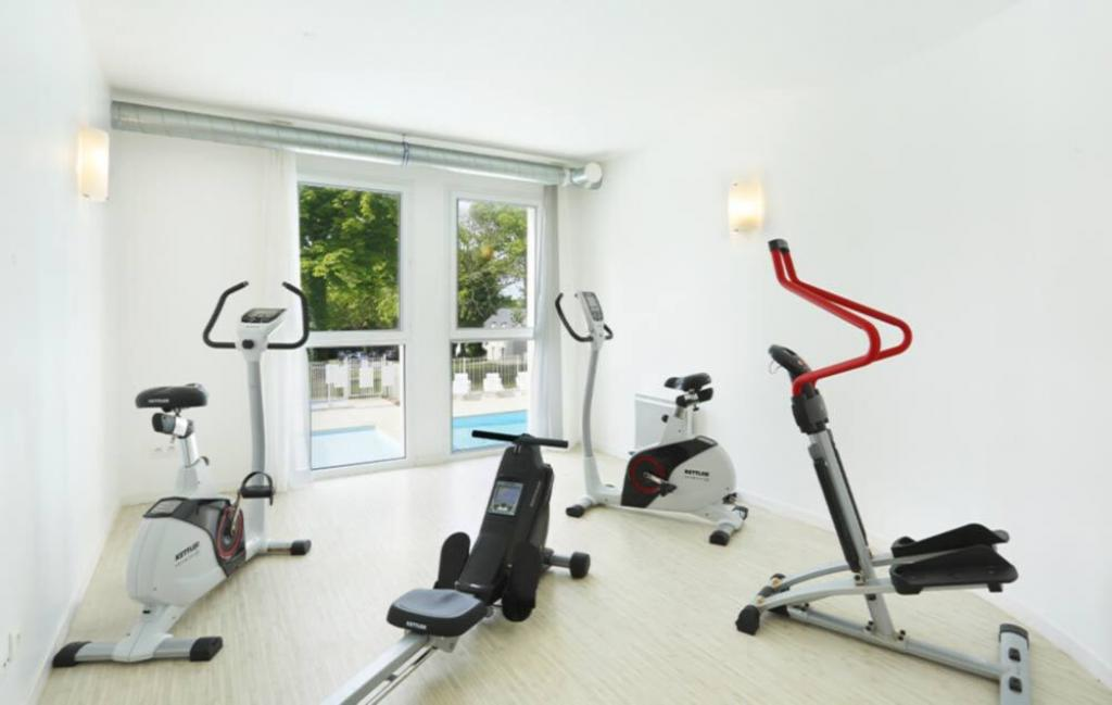Slide Salle de fitness - Le Domaine de la Baie ***
