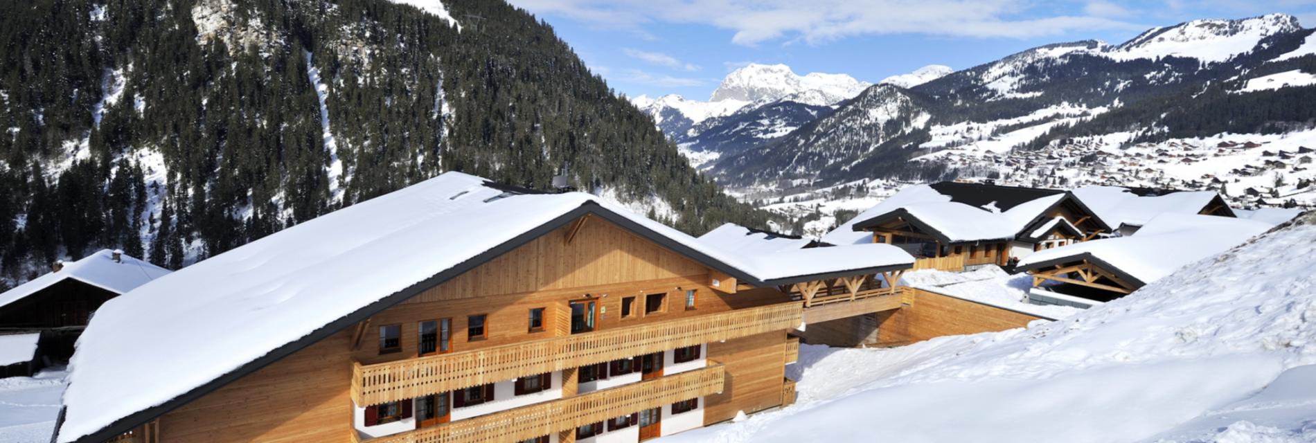 Slide La résidence le Grand Lodge sous la neige - Montagne Hiver