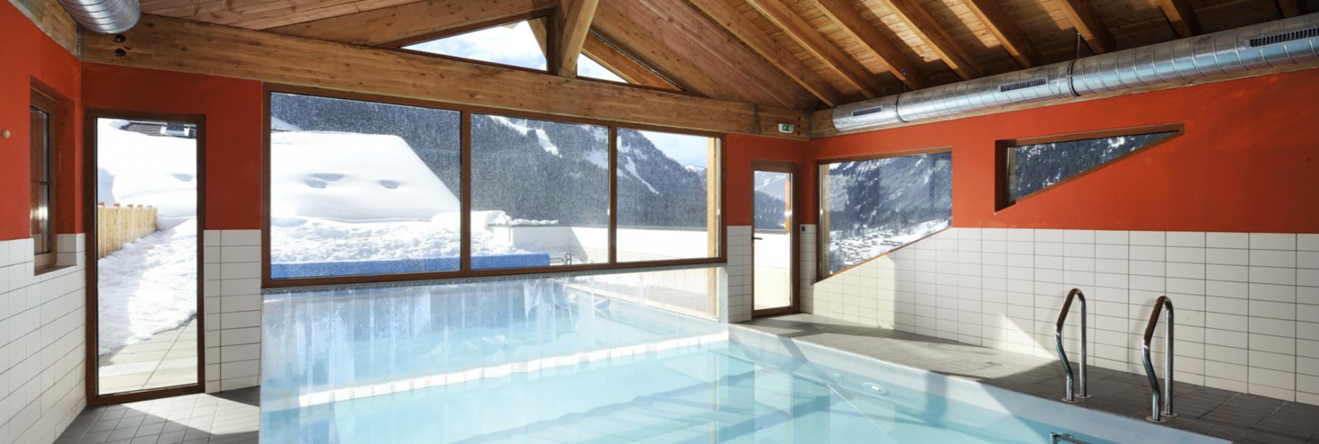 Slide Piscine intérieure La résidence le Grand Lodge Châtel - Montagne Hiver