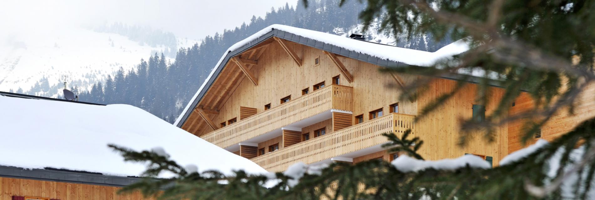 Slide Portrait de La résidence le Grand Lodge Châtel - Montagne Hiver